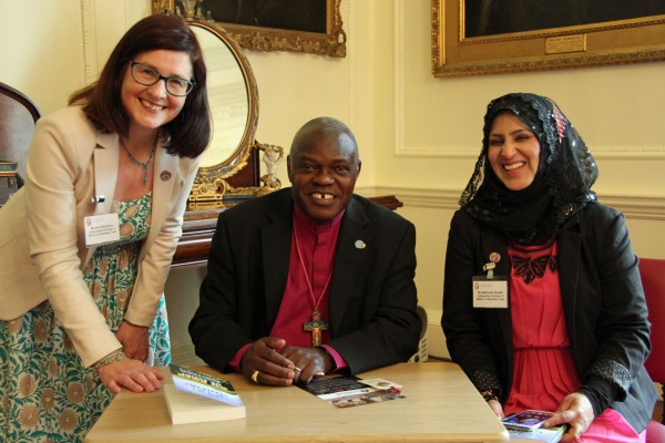 "Kim Strickson and Mashuda Shaikh with the Archbishop of York. Kim Strickson gave him a 6 million+ button badge. He signed his latest book ""On Rock or Sand"" to give to them. (Photo: Elizabeth Addy)"